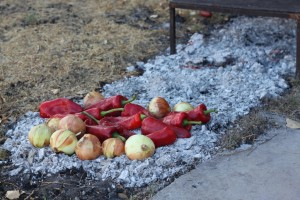 Onions and Peppers placed on a bed of coals prior to being covered.